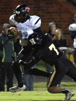 Mt. Juliet's Colby Martin rushes as Hendersonville's Logan Spurrier makes the tackle on Fri. Oct. 27, 2017.