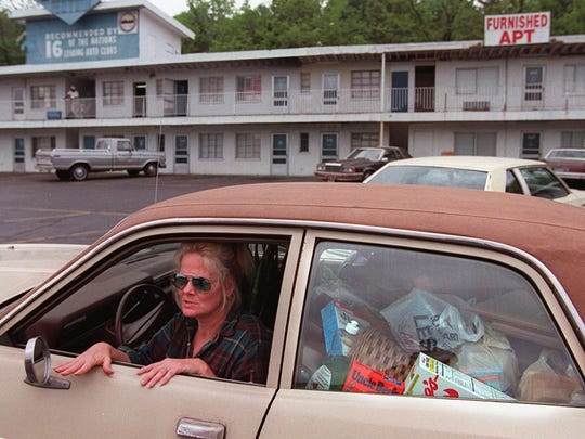 """In 1996 a resident of El Rancho Rankin with her belongings in tow. She was leaving the apartments anyway that day because she said the place was dirty and smelled.  """"we're (she and finacee) are poor but we're not dirty,"""" she explained."""