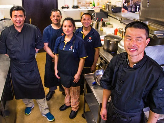 The kitchen staff poses at the Original Cuisine restaurant in Mesa, Wednesday, June 7, 2017. From left to right are; Qingquan Kang, chef, Shiming Guo, cook, Zhengshu Liu, cook, Zheqiang Hu, cook, and Yonghu Yin, chef.