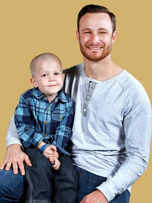 Beckett Roerdink, 4, of Greenville, meets Milwaukee Brewers player Jonathan Lucroy in Milwaukee, Wis. on Thursday, November 13, 2014. Lucroy became involved in the Catch a Star for Beckett initiative.  Sharon Cekada/Post-Crescent Media