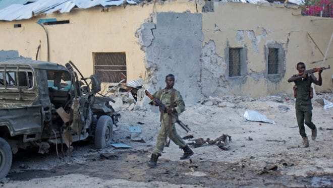 Somali soldiers take position after a bomb was detonated at the gate of one of Mogadishu's most popular hotel on March, 27, 2015.