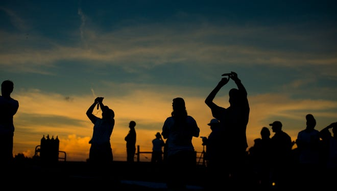 "Students and scientists take photos during eclipse totality at APSU""s farm in Clarksville on August 21, 2017."