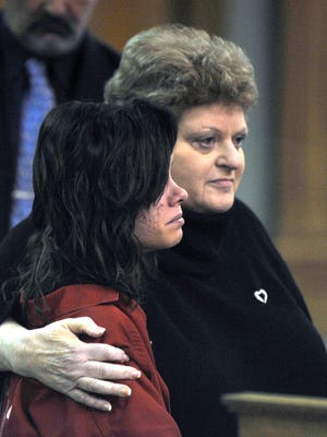 Roksana Sikorski, 15, with her attorney, Leslie Posner, faces charges Thursday in 35th District Court.