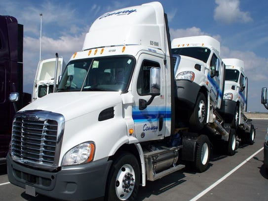 Cab extenders are fairings perched atop semitractors.