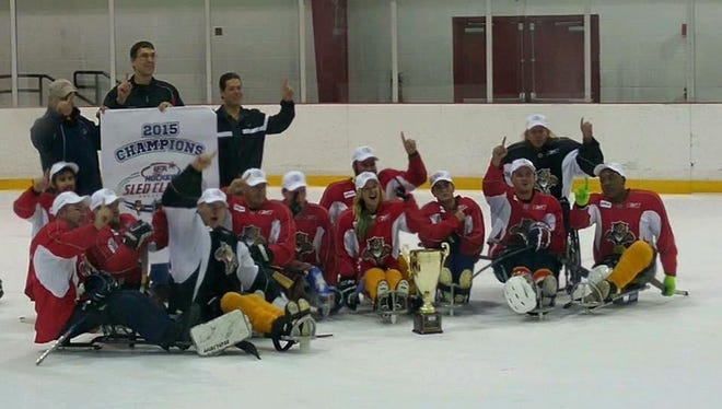 The Florida Sled Bandits celebrate their Tier I championship at the USA Hockey Sled Classic in Coral Springs.