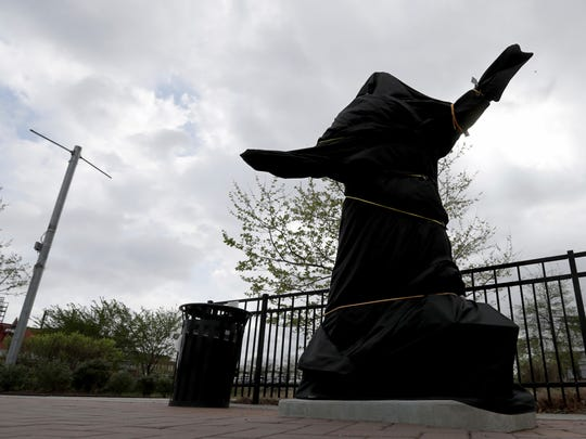 "The covered Kate Smith statue sits outside Wells Fargo Center in Philadelphia on Friday, April 19, 2019. The Philadelphia Flyers covered the statue of singer Kate Smith outside their arena, following the New York Yankees in cutting ties and looking into allegations of racism against the 1930s star with a popular recording of ""God Bless America."" Flyers officials said Friday they also plan to remove Smith's recording of ""God Bless America"" from their library. They say several songs performed by Smith ""contain offensive lyrics that do not reflect our values as an organization.""  (David Maialetti/The Philadelphia Inquirer via AP)"