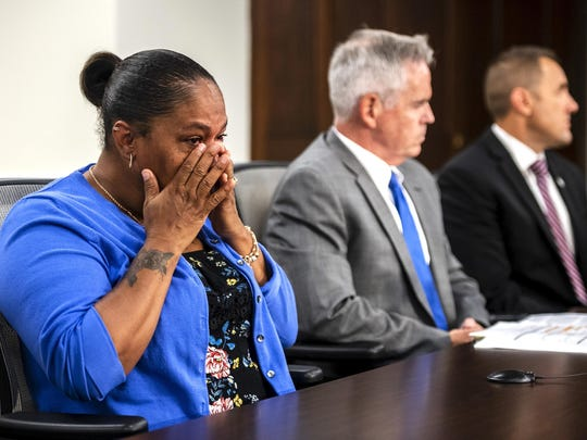 Taji Walsh, Nalani Johnson's grandmother, left, wipes away tears as Coleman McDonough, county police superintendent, center, and Chad Yarbrough, Federal Bureau of Investigation's assistant special agent, right, take questions from reporters during a briefing on the disappearance of her granddaughter Nalani Johnson, at Allegheny County Courthouse, Tuesday, Sept. 3, 2019, in Pittsburgh. Indiana County District Attorney Patrick Dougherty said the body of Johnson, who was to turn 2 this month, was found in Pine Ridge Park in Blairsville, east of Penn Hills, where authorities allege the girl was kidnapped Saturday evening. (Michael M. Santiago/Pittsburgh Post-Gazette via AP)