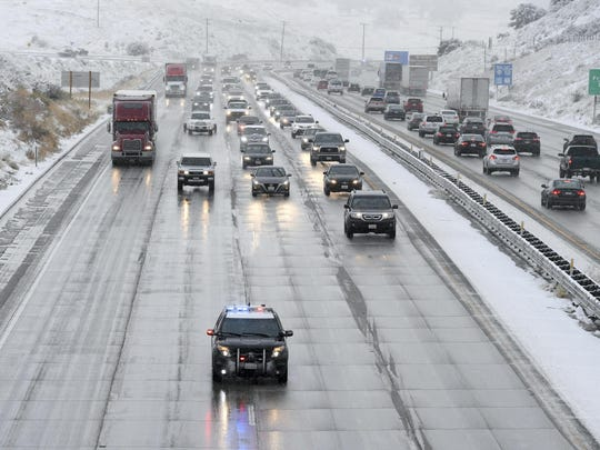 CHP guides traffic along the Interstate 5 freeway at the Tejon Pass, Calif., as travelers try to get in and out of Southern California for the Thanksgiving holiday, Wednesday, Nov. 27, 2019. Plows were running and CHP was guiding traffic in an attempt to keep the freeway open as long as possible.(David Crane/The Orange County Register via AP)