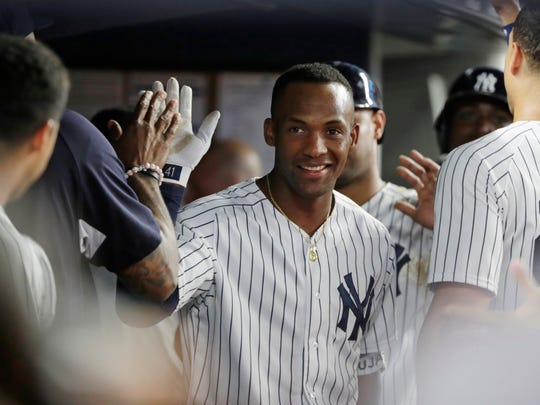 New York Yankees' Miguel Andujar celebrates with teammates after hitting a three-run home run during the fifth inning of a baseball game against the Baltimore Orioles Tuesday, July 31, 2018, in New York.