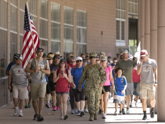 People make their way on Sunday, May 15, 2016, to Chase Field during the Phoenix leg of Carry the Load, a national relay held throughout the month of May in honor of those who have given their lives in service to their country.