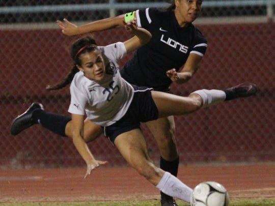 Tatiana Woolworth, of La Quinta High School, loses her balance during a play against Cathedral City High School in the first half of their home game. La Quinta won 1-0.