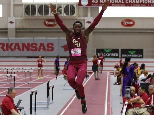 FSU's Corion Knight leaps to a personal-best long jump at the University of Arkansas.