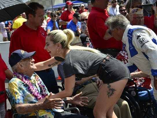 Lady Gaga greets one of the Pearl Harbor survivors