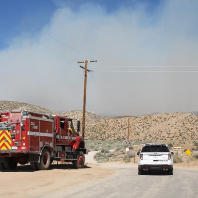 Firefighters gathered at the end of Burns Canyon Road near Pioneertown. They monitored the Lake Fire, which burned more than 30,000 acres.