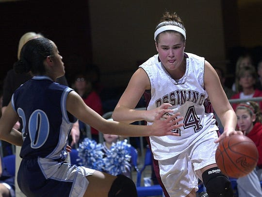 Ossining's Laura Brown drives around Ursuline's Jhany