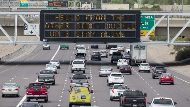"ADOT's ""Hello From the Other Side"" freeway sign, shown Aug. 17, 2016, on I-10 near downtown Phoenix, references Adele's hit song."