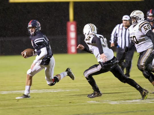 Creek Wood's Will Secker is chased by Springfield's Bryan Hayes.