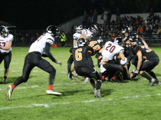 SPASH running back Gus Turner-Zick battles for more yardage in the second quarter Friday night against Marshfield at Beell Stadium.