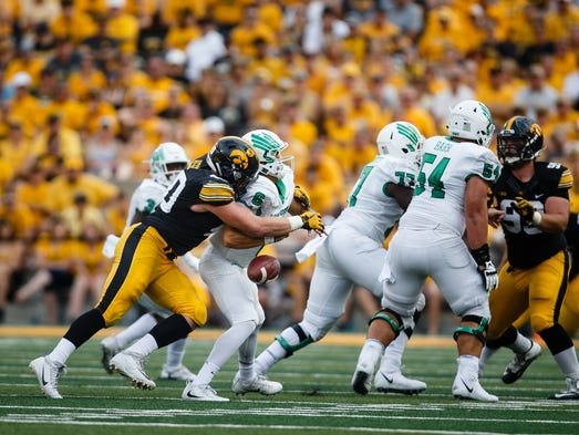 Iowa's Parker Hesse (40) sacks North Texas quarterback