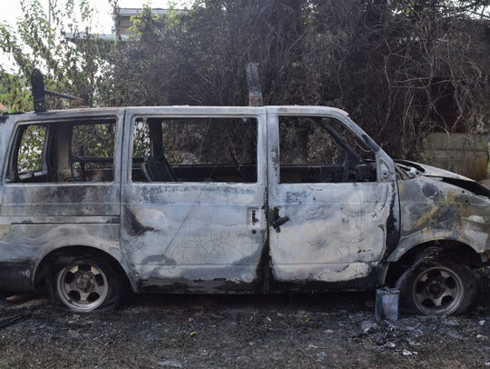 Pictured is a van that residents say was exploded by