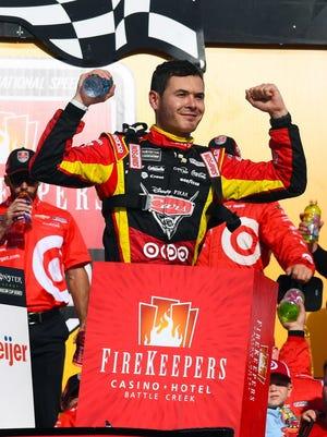 Kyle Larson (42) reacts after winning the FireKeepers Casino 400 at Michigan International Speedway.