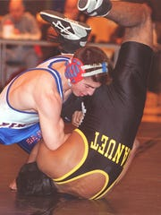 Pearl River's Matt Homenick on his way to pinning Nanuet's Steve Sunderaj at a wrestling meet in 2000.