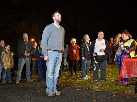 "U.S. Navy Lt. Cmdr. Joshua Corney stands at attention during the playing of the final amplified recording of ""Taps"" on his Glen Rock property Thursday, Nov. 30, 2017. Corney began playing ""Taps"" nightly at 8 p.m. in 2015, at a level estimated to be heard within a mile radius, which prompted two years of disputes and legal battles after neighbors brought complaints to the borough council. After the council voted unanimously to authorize the playing of ""Taps"" on speakers at Glen Rock Park, Corney agreed to lower the volume on his property."