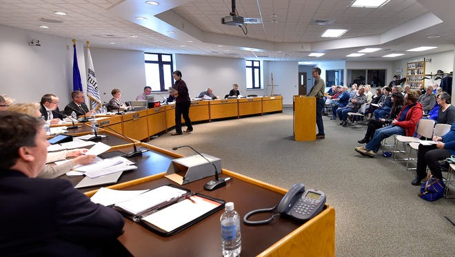 Dan Collins speaks in favor of voting against waterfront proposals 9, 10 and 11 in front of the Sturgeon Bay City Council on May 2, 2017, as fellow Friends Of Sturgeon Bay Waterfront member Nancy Aten hands out literature.