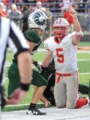 Shelby quarterback Brennan Armstrong celebrates scoring