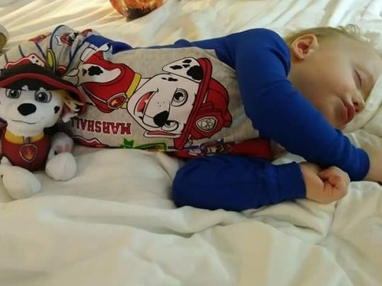 Niall Hoy, 2, of Iowa Falls, rests after doctors remove