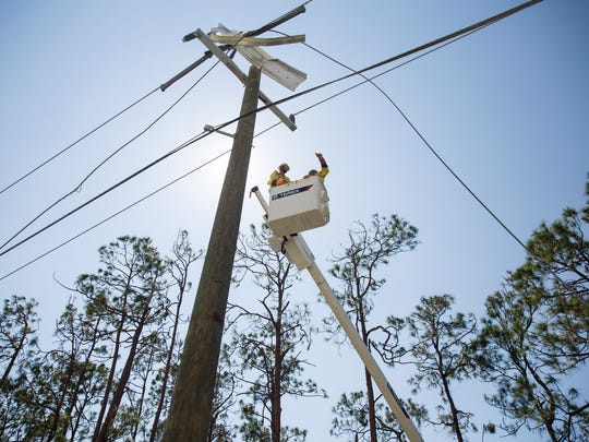 Employees of Irby Construction work to repair power lines in Naples on Monday, Sept. 18, 2017. Roughly 2,300 workers from the company were contracted to assist FPL in restoring power on Florida's west coast.