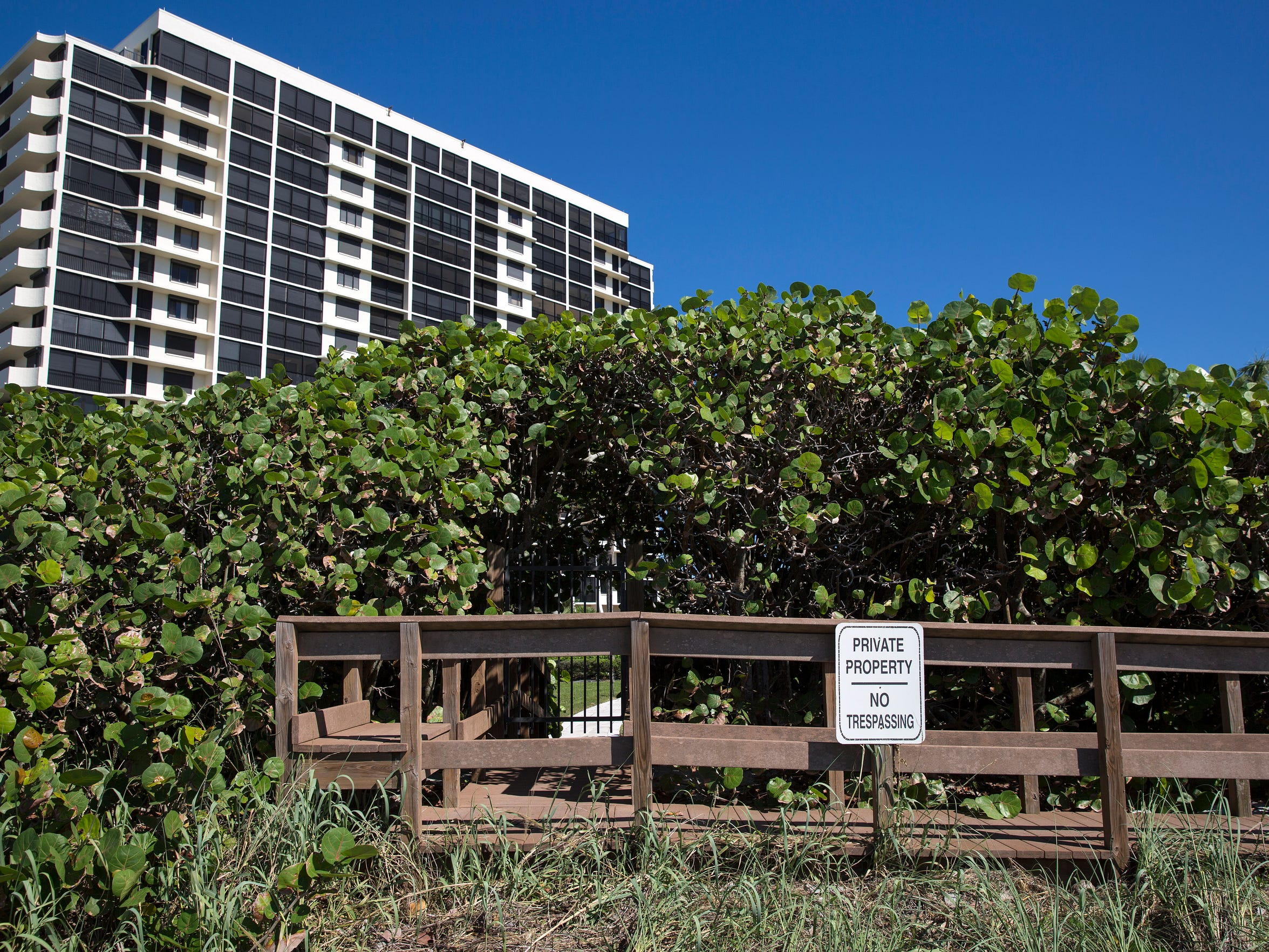 Signage as seen from the private stretch of beachfront outside of the Vanderbilt Gulfside II Condo on Thursday, Oct. 26, 2017.