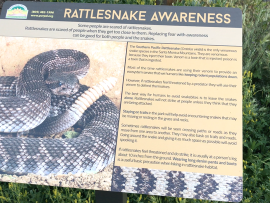 Signs at parks around Ventura County warn visitors of the presence of rattlesnakes and offer advice about how to react. STAR FILE PHOTO