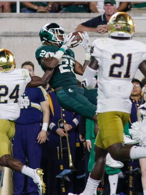 MSU WR Darrell Stewart Jr. tries to snag a fourth quarter pass against Notre Dame.  The pass was incomplete.