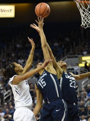 Nevada's Terae Briggs battles battles for a rebound