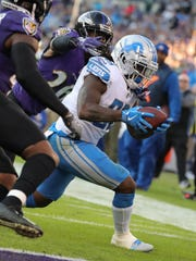Tion Green scores his first NFL touchdown in the third quarter of the Lions' 44-20 loss to the Ravens on Sunday.