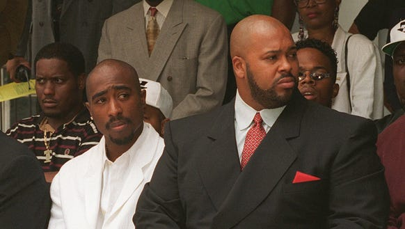 Shakur, left, and Death Row Records Chairman Marion