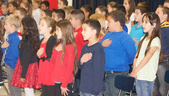 """Students at Jose Barrios Elementary School put on a program entitled """"Honoring All who Serve"""" on Wednesday in honor of Veterans Day. Hundreds of students and parents gathered in the elementary school gym to honor Grant County veterans for their service. To see more photos, visit the Sun-News Facebook page."""