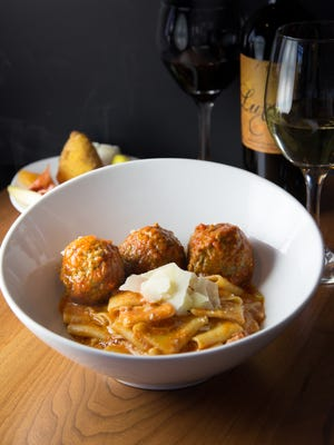 Meatballs with sauce over a pacceri pasta base from The Sicilian Butcher, now open in Scottsdale.