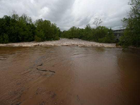 The Finley River rises as rains continue on Saturday,