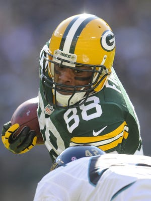 Former Green Bay Packers tight end Jermichael Finley, seen during a game against the Jacksonville Jaguars at Lambeau Field on Oct. 28, 2012, has retired. He sustained a career-ending neck injury two years ago.