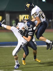 Chambersburg's Clay Myers, left, catches a deep pass