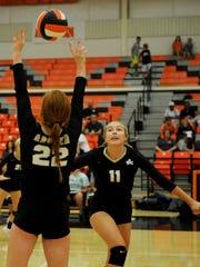 Archer City's Sierra Mooney sets the ball for Lauren