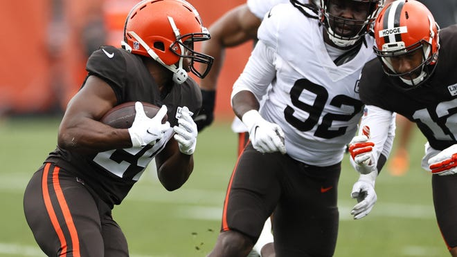 Cleveland Browns running back Nick Chubb runs the ball during practice at the NFL football team's training facility Monday, Aug. 17, 2020, in Berea, Ohio.