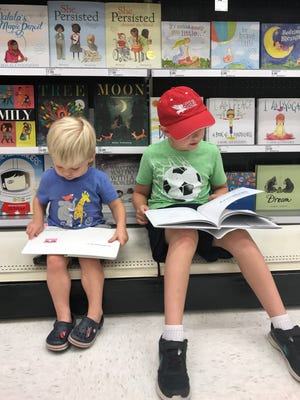 .Austin 6, and Alex, 2 can't leave a store without first checking out their book selection