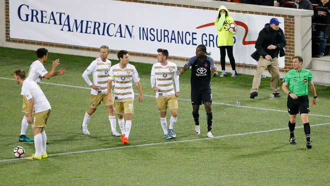 FC Cincinnati forward Djiby Fall (9), center right, is issued a red card in the second half.
