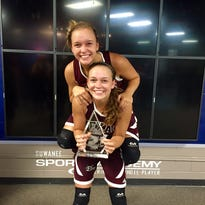 Hannah Hand, pictured on her sister Rebekah's back, after the two won an AAU national title. The two have verbally committed to play basketball at Marist College.