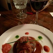 """A """"beggar's purse"""" filled with shitake mushrooms, goat's cheese and roasted red pepper sauce, paired with """"Well the Spur."""""""