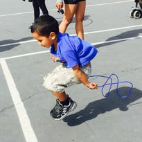 A student participates in FAMFEST, a recent event supporting recess activities and their behavioral benefits.