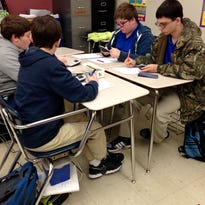 """Eighth-graders at Oak Hill High School in Elmer work through problems in groups of four on Tuesday. April Durand uses PARCC-like problems as daily """"bell ringers"""" to give students an idea of what to expect on the state standardized test to be administered starting March 16."""